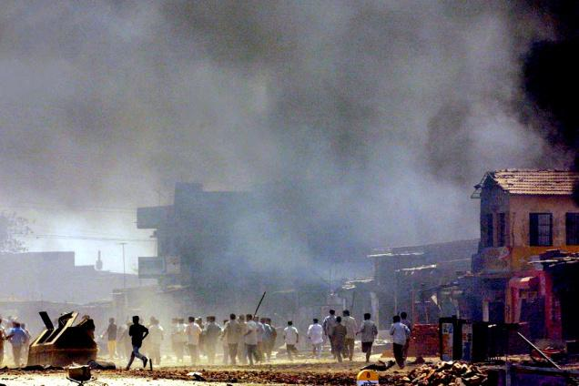 A 2002 file photograph of rioters in Ahmedabad. Associated Press/The Hindu.